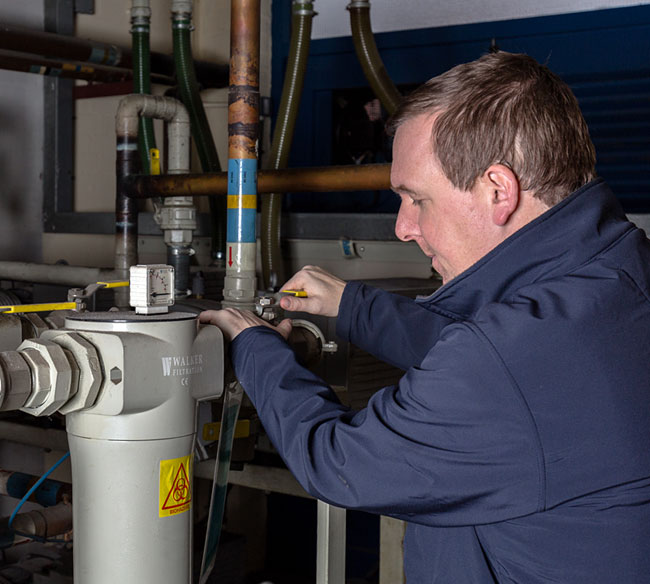 A photo of a team member working on a gas pipe